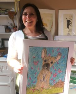 Artist Amanda Reynolds in her art studio based in Yorkshire with a pet portrait