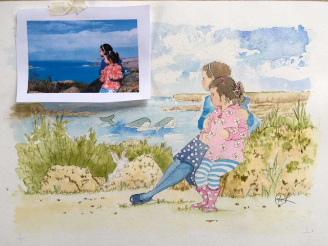 Beautiful family portrait watercolour painting of two girls looking out to the open ocean watching two whales in the bay. A small white rabbit peeps out at the two little girls from behind a rock.