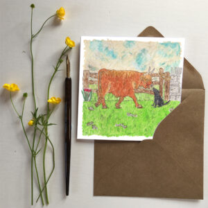 Greetings card featuring a Highland Cow and Black Labrador oil pastel painting by artist Amanda Reynolds depicts a curious highland cow and black Labrador meeting each other in a countryside field with an old wooden gate in the background.