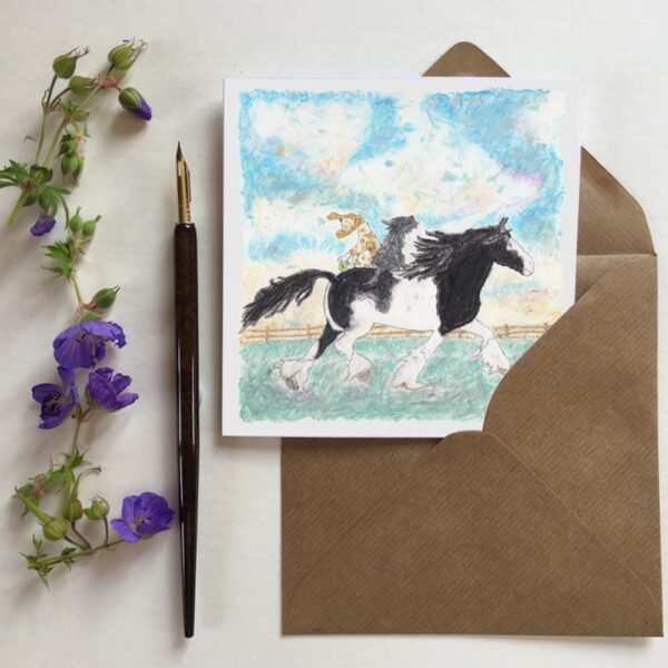 Great Day For A Joyride greeting card featuring a beautiful black and white shire horse. Riding bare back are two happy dogs living their best life.