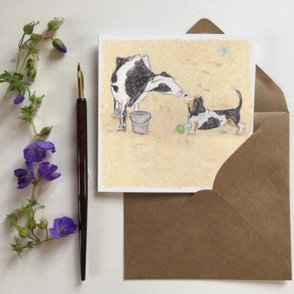 New Friends greetings card with cute dairy cow and lovely little basset hound are seen making friends in this picture.